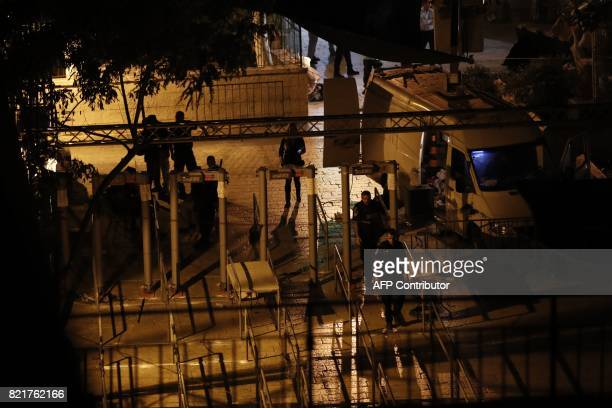 Israeli security forces take down security barriers at the Lions' Gate a main entrance to the AlAqsa mosque compound in Jerusalem's Old City on July...