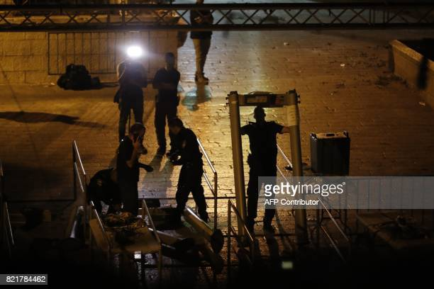 TOPSHOT Israeli security forces take down security barriers near Lions' Gate a main entrance to the AlAqsa mosque compound in Jerusalem's Old City on...