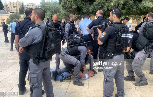 Israeli security forces take into custody a Palestinian as Jewish extremists make a raid on Al-Aqsa Compound in East Jerusalem on May 23, 2021.