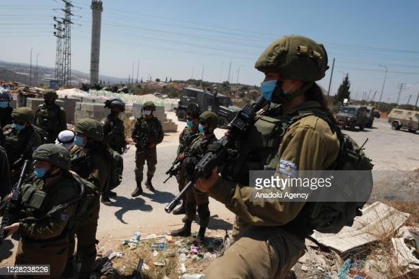 Israeli security forces take measures as Palestinian demonstrators gather for a demonstration against the plan of the construction of Jewish...