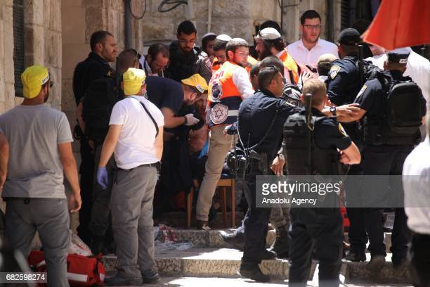 Israeli security forces take security inspect the crime scene after a Palestinian man was shot dead in an alleged stabbing attack in East Jerusalem,...