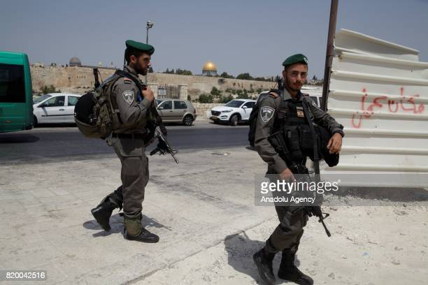 Israeli security forces take security measures as Palestinians gather for Friday prayer near new security metal detectors as they refuse to enter...