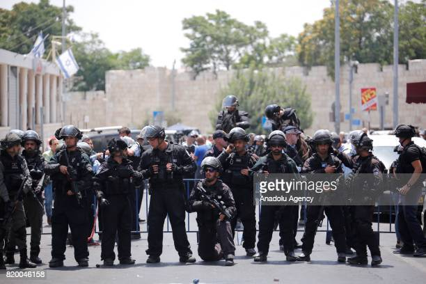 Israeli security forces take security measures as Palestinians gather for Friday prayer outside AlAqsa's Bab alSahira in Jerusalem on July 21 2017...