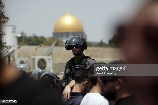 Israeli security forces take security measures as Palestinians gather for Friday prayer outside AlAqsa Mosque in Jerusalem on July 21 2017 Israeli...