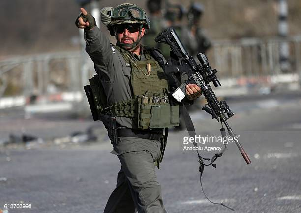 Israeli security forces take security measures as Palestinians stage a protest showing solidarity with Misbah Abu Sbeih in the West Bank town of...