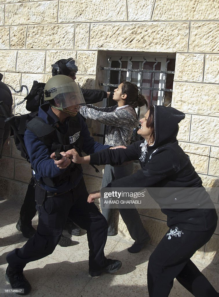 Israeli security forces try to arrest Palestinian protestors following a demonstration in support of Samer Issawi, a Palestinian prisoner who has been on hunger strike for more than 200 days in an Israeli pirson, in the Arab east Jerusalem neighbourhood of Issawiya on February 15, 2013. A United Nations official on February 13, expressed concern about the wellbeing of Palestinian detainees in Israeli prisons and in particular about the condition of Issawi.