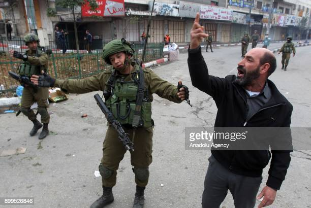 Israeli security forces try to disperse Palestinian protestors as they protest against the US President Donald Trumps recognition of Jerusalem as...