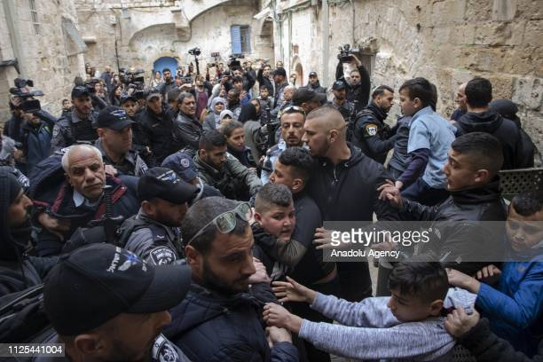 Israeli security forces try to take a Palestinian into custody in front of a house after Israeli security forces evicted the owners Palestinian Abu...