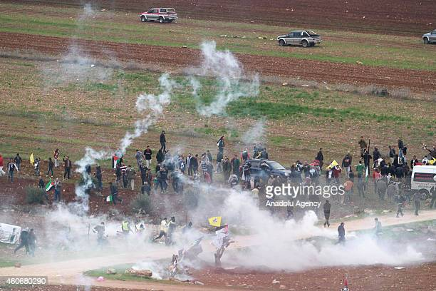 Israeli security forces use plastic bullets and tear gas to disperse the Palestinians protesting the separation barrier during a commemoration...