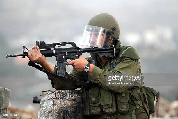 Israeli security forces use tear gas and plastic bullets during the clashes with Palestinians in Ramallah West Bank on October 31 2014 Palestinians...