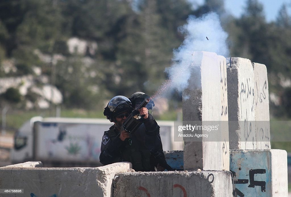 Israeli security forces use tear gas as Birzeit University students march beside Ofer Prison to show solidarity with Palestinian prisoners on February 28, 2015.