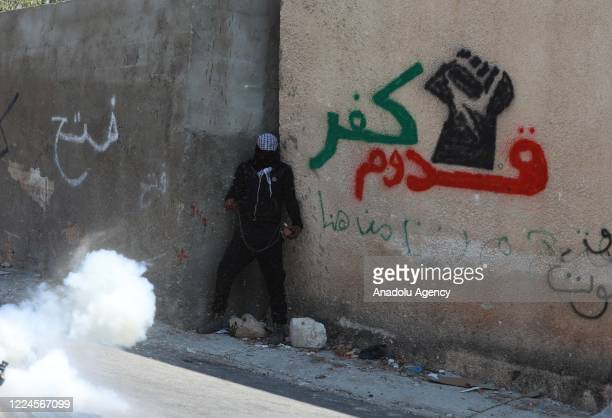 Israeli security forces use tear gas as they intervene in the demonstration of Palestinians to protest against construction of Jewish settlements and...