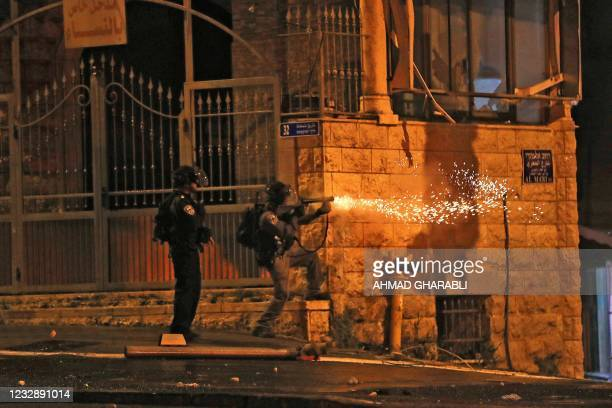 Israeli security forces use tear gas to disperse protesters in the Shuafat Palestinian neighbourhood, neighbouring the Israeli settlement of Ramat...