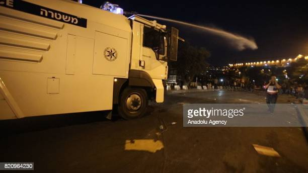 Israeli security forces use water cannon on Palestinians who gathered to perform the evening prayer in front of the Lion's Gate, at Al Aqsa Mosque,...