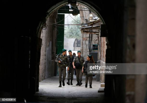 Israeli security forces walk in the Jerusalem's Old City near the alAqsa mosque compound the third holiest site in Islam and also venerated by Jews...