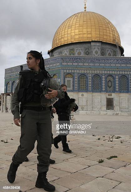 Israeli security forces walk near Jerusalem's Dome of the Rock mosque in the AlAqsa mosque compound the third holiest site in Islam but also the most...