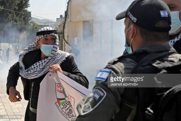 Israeli security members clash with Palestinian demonstrators commemorating land day and protesting settler visits to archaeological and historical...