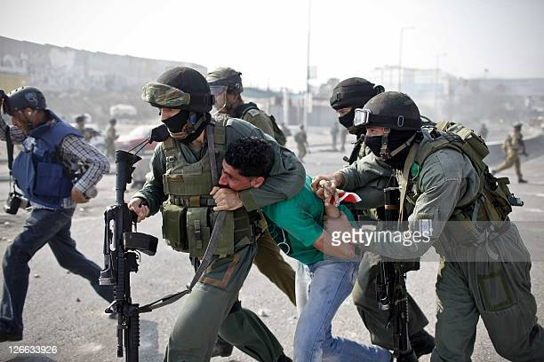 BYLINE Israeli security officers detain a Palestinian youth during clashes that erupted between the security officers and Palestinian stonethrowers...