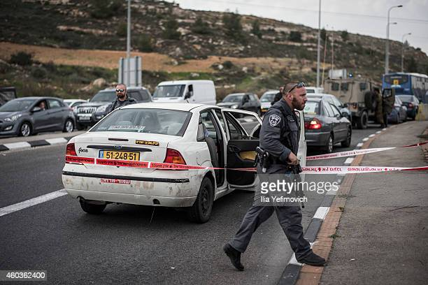 Israeli security personal stand near the site of an acid attack site on December 12 2014 in Hussan West Bank An Israeli family attempted to pick up a...