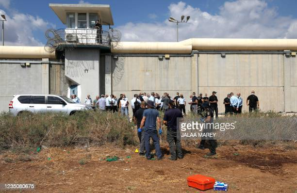 Israeli security personnel search for evidence outside the Gilboa Prison in northern Israel after six Palestinians broke out, on September 6, 2021. -...