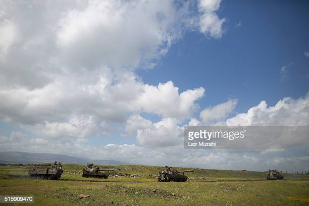 Israeli selfpropelled guns are seen during an army drill on March 16 2016 in Israeliannexed Golan Heights Israeli President Reuven Rivlin landed in...