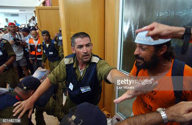 Israeli settlers are evacuated from the synagogue of the southern Gaza Strip settlement of Neve Dekalim Thursday August 18 2005 Israeli police...