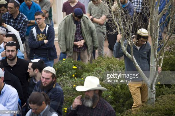 Israeli settlers attend the funeral of Rabbi Itamar Ben Gal in the West Bank settlement of Har Bracha on February 6 after he was killed the previous...