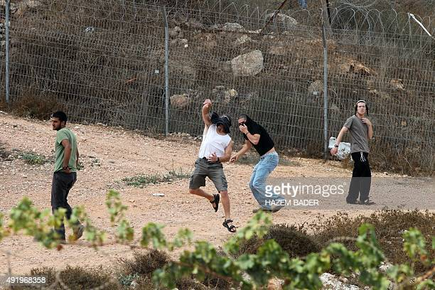 Israeli settlers clash with Palestinians near the site of a reported stabbing attack by a Palestinian on an Israeli settler near the Israeli...