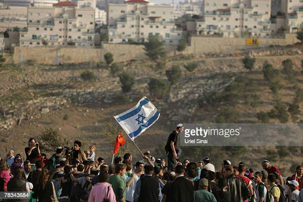 Israeli settlers dance and sing as they arrive to the hills at the new E1 settlement area on December 9 2007 near the Israeli settlement of Maale...