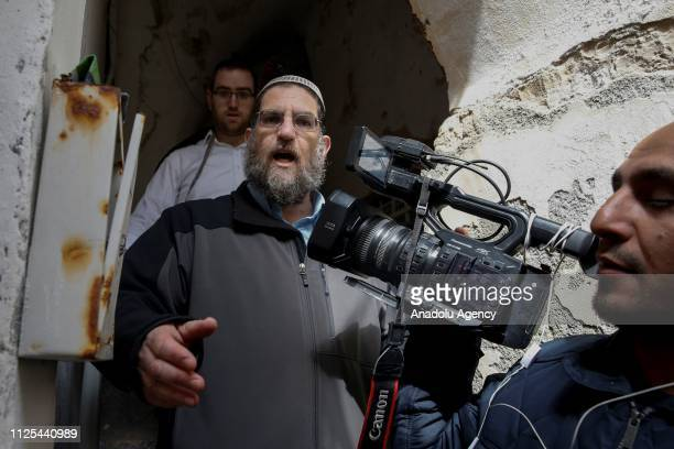 Israeli settlers intervene in press members in front of a house after Israeli security forces evicted the owners Palestinian Abu Assab family in Old...