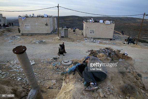 Israeli settlers prepare for the arrival of Israeli riot police into the settlement on February 1 2006 in the West Bank outpost of Amona The eighty...