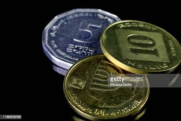 israeli shekel currency on black background - global awards stock pictures, royalty-free photos & images