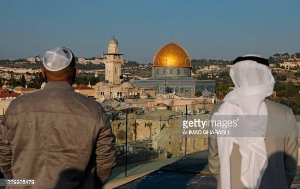 Israeli singer Elkana Marziano and Emirati singer Walid Aljasim look towards the Al-Aqsa mosques compound, Islam's third holiest shrine, during a...