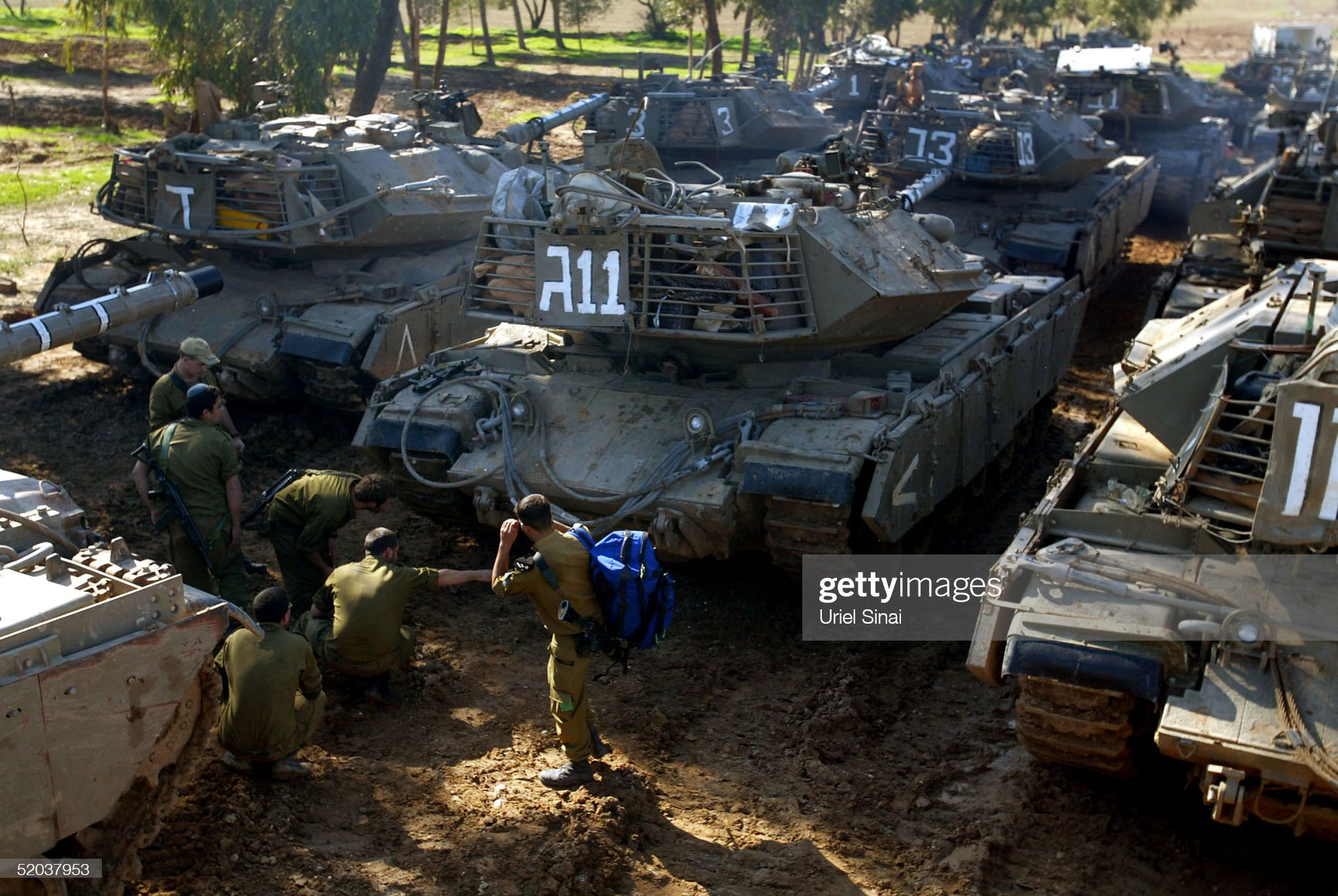 https://media.gettyimages.com/photos/israeli-sodiers-inspect-a-column-of-parked-tanks-near-the-border-of-picture-id52037953?s=2048x2048