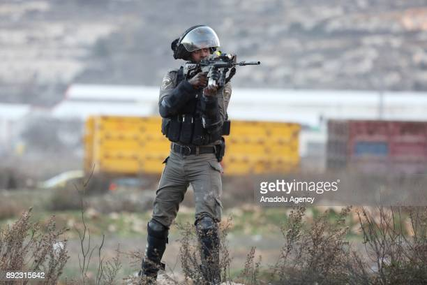 Israeli soldier intervene to Palestinian protesters during a demonstration against US President Donald Trump's recognition of Jerusalem as Israel's...