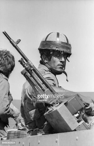 Israeli soldier on top of his tank one hand on his machine gun during the Yom Kippur war