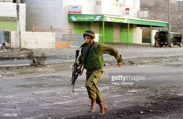 Israeli soldier runs during clashes with Palestinians in Ramallah junction on October 12 in the West Bank The Palestinian Authority The Israeli armys...