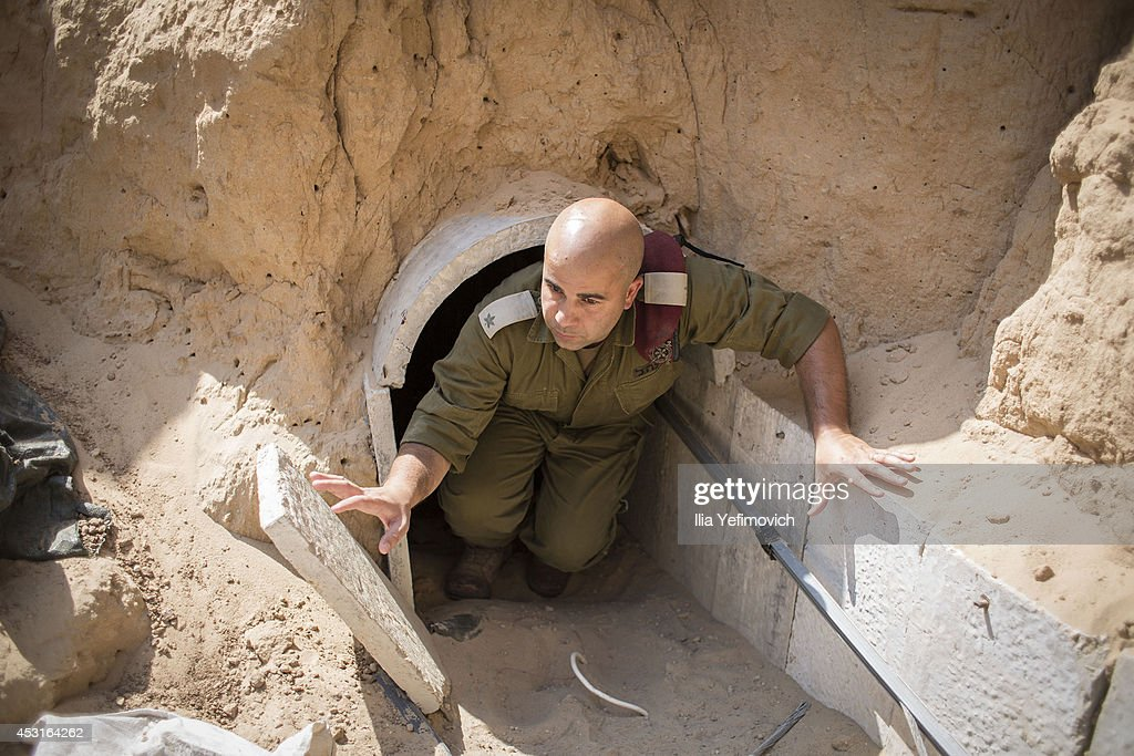 Israeli soldier seen inside a tunnel built underground by Hamas militants leading from the Gaza Strip into Southern Israel, seen on August 4, 2014 near the Israeli Gaza border, Israel. As Operation Protective Edge enters its 28th day, the Israeli mission of demolishing Hamas tunnels comes to a close and ground forces returned from Gaza, while Israeli airstrikes in Gaza and Hamas rocket fire to Israeli continues. Palestinian groups including envoys of Hamas and Islamic Jihad held their first formal meeting in Cairo hoping to secure a durable ceasefire with Israel.