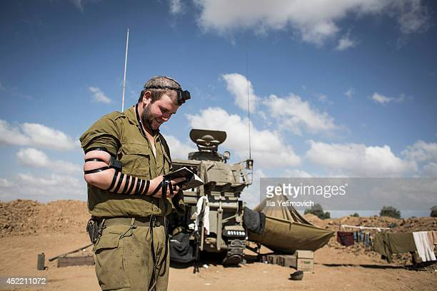 Israeli soldier seen praying by artillery cannon on July 16 2014 at the IsraeliGaza border An Egyptian ceasefire proposal was yesterday refused by...