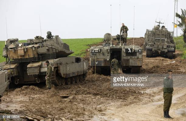 TOPSHOT Israeli soldiers and their tanks are seen monitoring the area of the southern Israeli kibbutz of Nir Am near the border with Gaza on February...