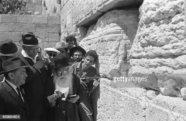 Israeli soldiers and ultraorthodoxe Jews pray 09 June 1967 at the Wailing Wall in Jerusalem after Tsahal conquiered over Jordan the eastern part of...