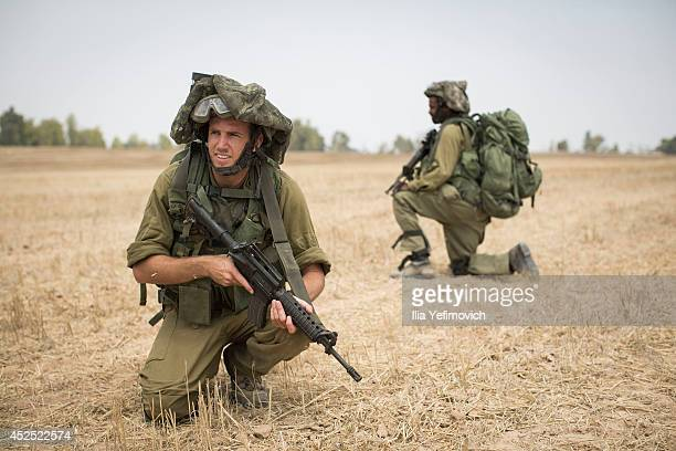 Israeli soldiers are seen during a drill on July 22 2014 by Israeli Gaza border Israel As operation 'Protective Edge' goes into it's third week the...