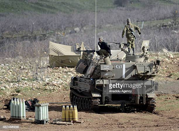 Israeli soldiers are seen on a military armored vehicle near the border with Lebanon in the Israeliannexed Golan Heights on January 29 2015 Hezbollah...