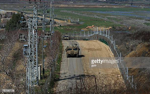 Israeli soldiers are seen patroling their country's side of the border with Lebanon in a picture taken from the southern Lebanese village of Kfar...