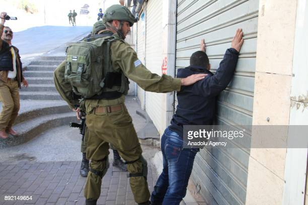 Israeli soldiers arrest a Palestinian boy with Down syndrome Mohamed alTaweel during protests against US President Donald Trump's decision to...