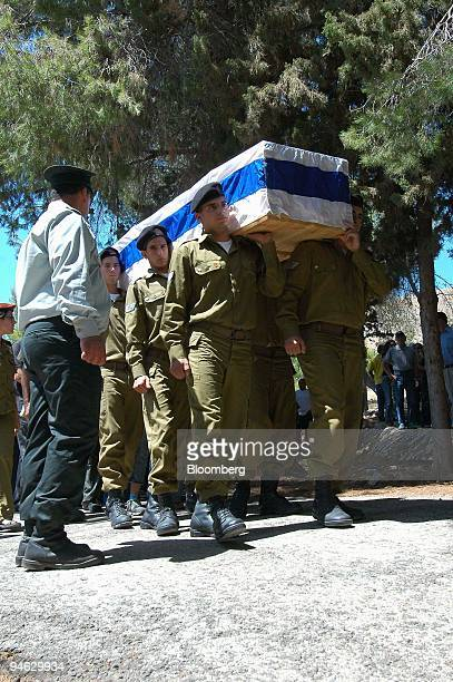 Israeli soldiers carry the coffin of First Sergeant Nimrod Segev during his funeral at a cemetery in the northern Israeli town of Rosh Pina Israel...