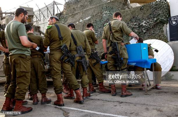 TOPSHOT Israeli soldiers cast their votes at the Erez army base in the south of Israel near the border with the Gaza strip on April 7 as they vote...