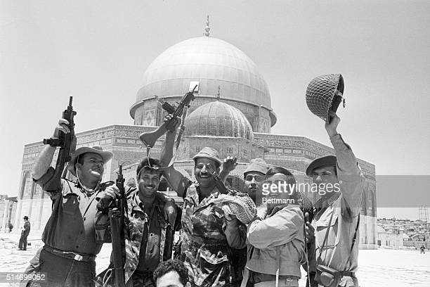 Israeli soldiers celebrate the capture of Old Jerusalem from the Jordanians They cheer in front of the Dome of the Rock a mosque sacred to all Muslims