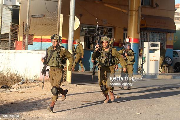 Israeli soldiers clash with Palestinians during a protest against the expropriation of Palestinian land by Israel and the Israeli Wall of Shame the...