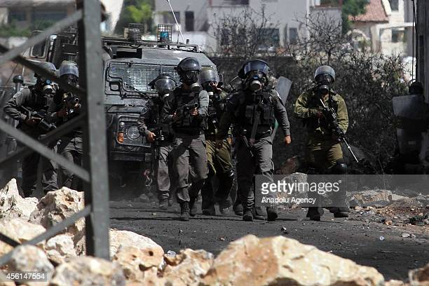 Israeli soldiers clash with Palestinians following a protest against the expropriation of Palestinian land by Israel and the Israeli Wall of Shame...